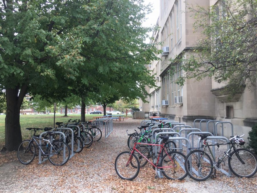 Several bikes are parked in Uni's bike holders.