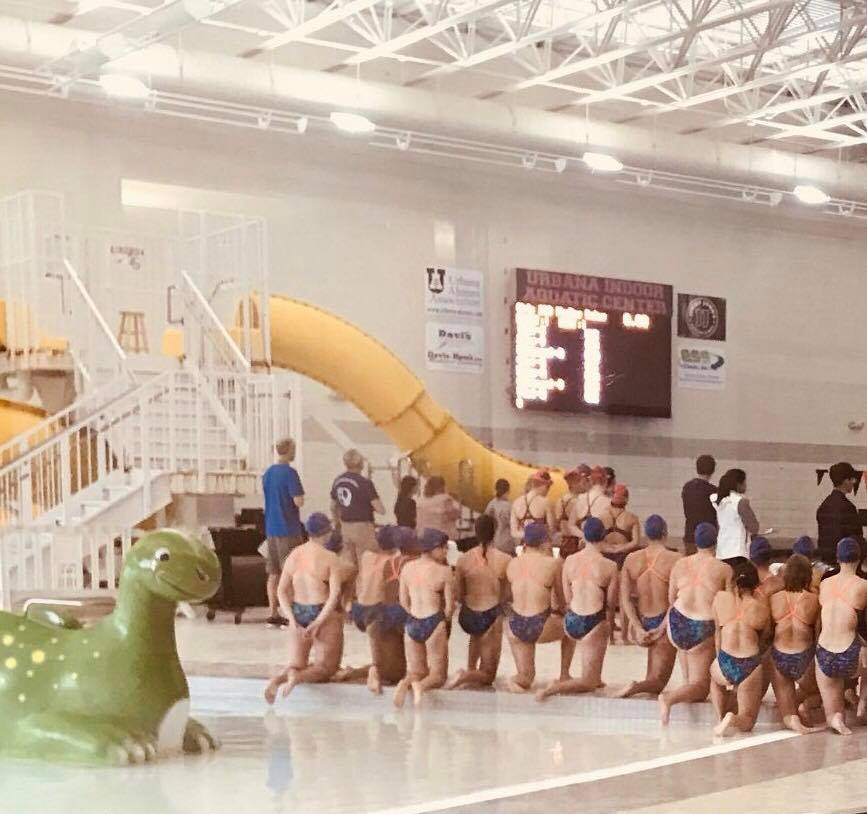 Swimmers kneel for the national anthem