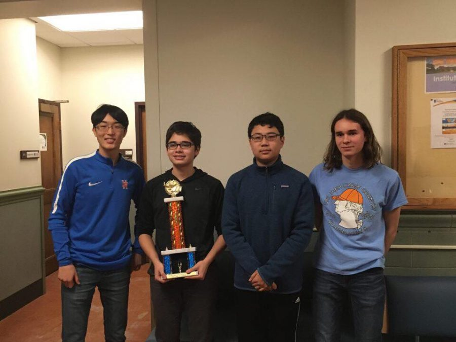 The+Scholastic+Bowl+team+pose+with+their+state+championship+trophy.+%28L-R%29+junior+Tim+Cho%2C+sophomore+Dylan+Bowman%2C+freshman+Jonathan+Lau%2C+and+sophomore+Ethan+Ashbrook.+Photo+courtesy+of+Dylan+Bowman.+