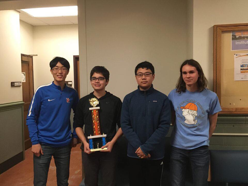 The Scholastic Bowl team pose with their state championship trophy. (L-R) junior Tim Cho, sophomore Dylan Bowman, freshman Jonathan Lau, and sophomore Ethan Ashbrook. Photo courtesy of Dylan Bowman.