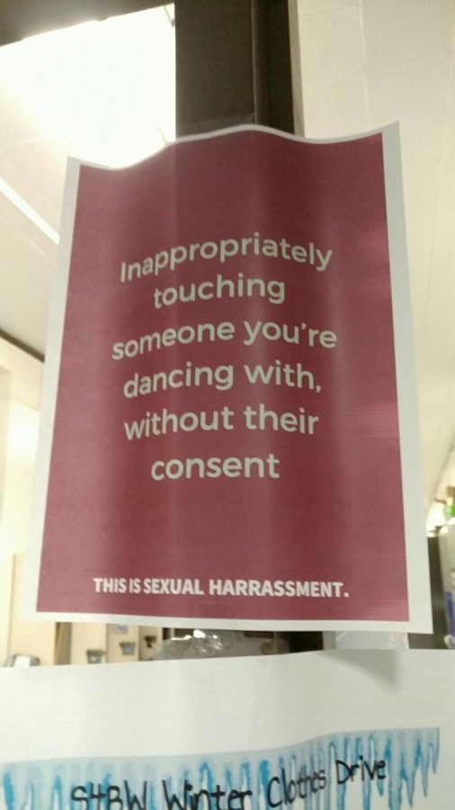 Posters on harassment placed around the building