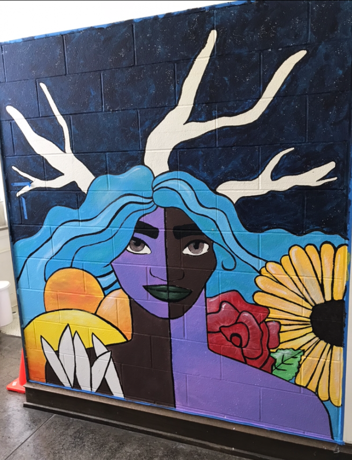 Maya Greer paints mural in girl's bathroom